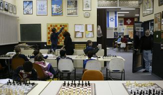 **FILE** Israeli youth attend a class at the chess club in the southern Israeli city of Beersheba, on Nov. 28, 2004. (Associated Press)