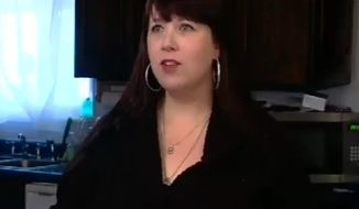 Jen Palmer of Utah, seen here in a screen shot, said she and her husband face $3,500 in fines and a damaged credit score for posting a negative review online about a company they had tried to buy Christmas presents from several years ago. (kutv.com)