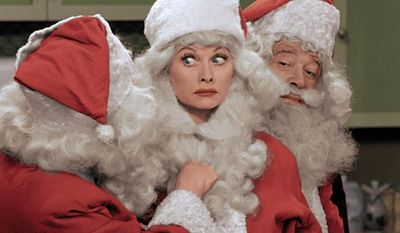 "** FILE ** This image released by CBS shows Lucille Ball, center, dressed as Santa Claus in a colorized ""I Love Lucy Christmas Special,"" which aired on Friday, Dec. 20, on CBS. (AP Photo/CBS)"