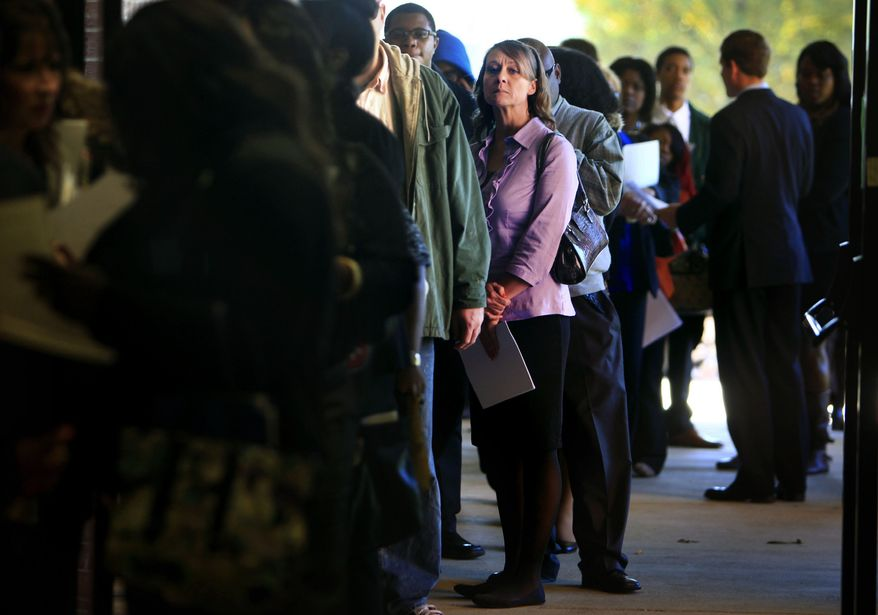 **FILE** Jona Caldwell joins a long line of job seekers outside the Ferguson Community Center in Cordova, Tenn., on Nov. 7, 2013. (Associated Press/The Commercial Appeal, Jim Weber)