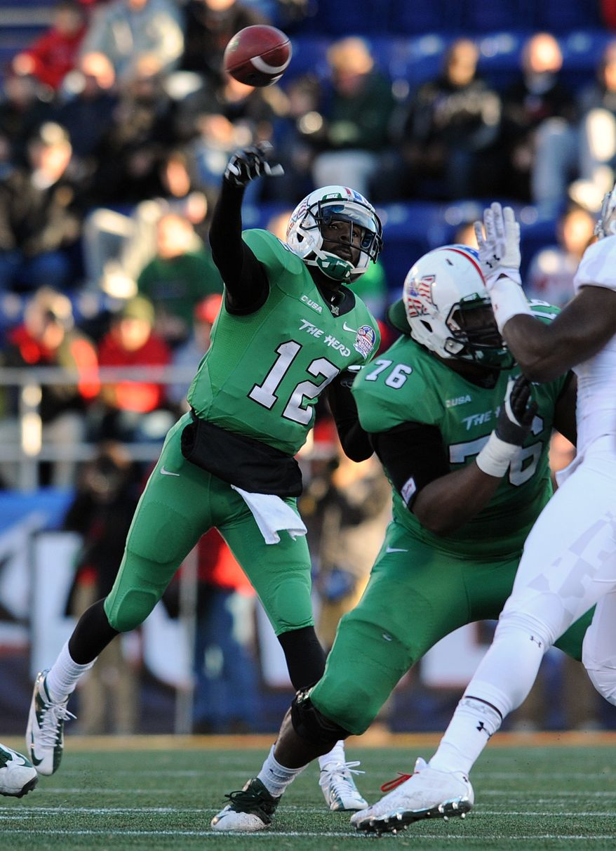 Marshall quarterback Raheem Cato (12) throws as Maryland applies pressure in the first half of the Military Bowl NCAA college football game on Friday, Dec. 27, 2013, in Annapolis, Md.(AP Photo/Gail Burton)