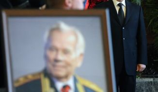 "Russian President Vladimir Putin attends a memorial service for Russian firearms designer Mikhail Kalashnikov in Moscow, Russia, Friday, Dec. 27, 2013. Kalashnikov died on Dec. 23 at the age of 94. His work as a weapons designer for the Soviet Union is immortalized in the name of the world's most popular firearm, the AK-47 assault rifle, which is often called ""a Kalashnikov."" (AP Photo/Sergei Chirikov, Pool)"