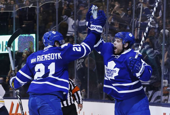 Toronto Maple Leafs' Phil Kessel, right, celebrates his goal with James van Riemsdyk during the second period of an NHL hockey game against the Buffalo Sabres on Friday, Dec. 27, 2013, in Toronto. (AP Photo/The Canadian Press, Mark Blinch)
