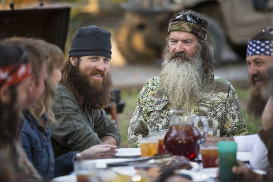"** FILE ** This undated image released by A&E shows Phil Robertson, flanked by his sons Jase Robertson, left, and Willie Robertson from the popular series ""Duck Dynasty."" (AP Photo/A&E, Zach Dilgard)"