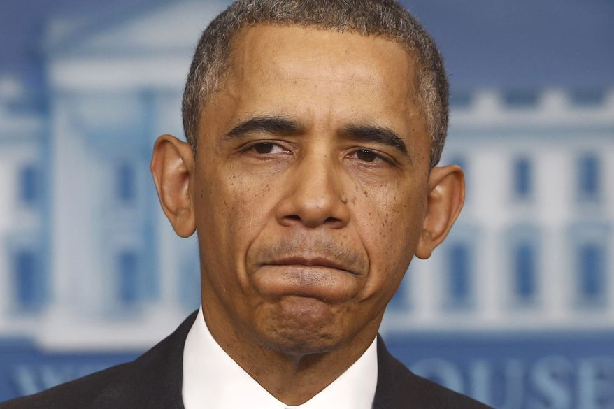 **FILE** President Obama pauses while speaking about his signature health care law in the Brady Press Briefing Room of the White House on Nov. 14, 2013. (Associated Press)