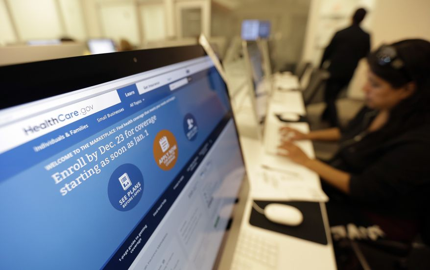 ** FILE ** In this Dec. 11, 2013, file photo, Rosemary Cabelo uses a computer at a public library to access the Affordable Health Care Act website, in San Antonio. The Obama administration says following a December surge, more than 1.1 million people have now enrolled for health insurance through the federal government's improved website. (AP Photo/Eric Gay, File)