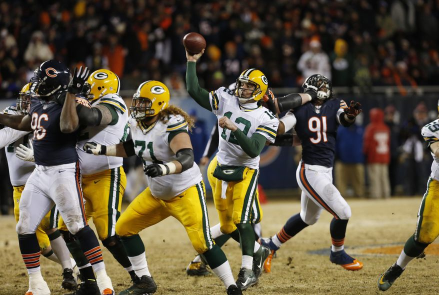 Green Bay Packers quarterback Aaron Rodgers (12) throws a pass during the second half of an NFL football game against the Chicago Bears, Sunday, Dec. 29, 2013, in Chicago. (AP Photo/Charles Rex Arbogast)