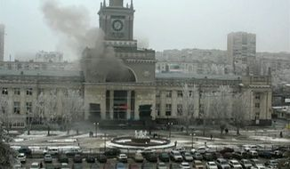 In this photo made by a public camera and made available by the Associated Press Television News  smoke pours out  after an explosion at Volgograd railway station, in Volograd Russia on Sunday, Dec. 29, 2013. More then a dozen people were killed and scores were wounded Sunday by a suicide bomber at a railway station in southern Russia, officials said, heightening concern about terrorism ahead of February's Olympics in the Black Sea resort of Sochi. (AP Photo/ Associated Press Television News)