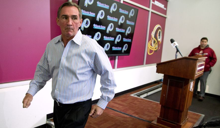Former Washington Redskins head coach Mike Shanahan walks away from the podium after making a statement after he was fired on Monday, Dec. 30, 2013, at Redskins Park, in Ashburn, Va. Shanahan was fired after a morning meeting with owner Dan Snyder and general manager Bruce Allen. (AP Photo/ Evan Vucci)