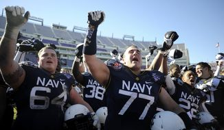 Navy players celebrate after singing the alma mater after their 24-6 win over Middle Tennessee in the Armed Forces Bowl NCAA college football game, Monday, Dec. 30, 2013, in Fort Worth, Texas. (AP Photo/Matt Strasen)