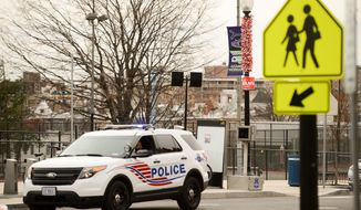 A pedestrian right of way camera sits at the intersection of 18th Street and Wyoming Avenue, NW, Washington, D.C., Monday, December 30, 2013. The Metropolitan Police Department is delaying the start to issuing tickets for 130 new traffic enforcement cameras in the District. Drivers will begin getting fines for speeding and violations at stop signs, crosswalks and intersections beginning in an unannounced time in the future. (Andrew Harnik/The Washington Times)