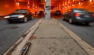 A speed camera is positioned underneath Washington Circle Park for east bound traffic  on K Street, N.W., Washington, D.C., Monday, December 30, 2013.  (Andrew Harnik/The Washington Times) **FILE**