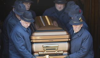 ** FILE ** Pallbearers carry the coffin of Vito Rizzuto, reputed mafia boss of Canada, from a church in Montreal, Monday, Dec. 30, 2013, following his funeral. Rizzuto died on Dec. 23 in Montreal. He was 67.  (AP Photo/The Canadian Press, Graham Hughes)