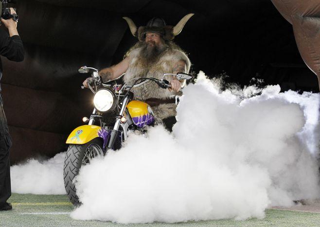 Minnesota Vikings mascot Ragnar waits to ride onto the field before an NFL football game against the Detroit Lions, Sunday, Dec. 29, 2013, in Minneapolis. (AP Photo/Ann Heisenfelt)