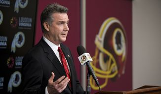 Washington Redskins Executive Vice President/ General Manager Bruce Allen answers a question during a news conference after the firing of head coach Mike Shanahan at Redskins Park on Monday, Dec. 30, 2013, in Ashburn, Va. (AP Photo/ Evan Vucci)