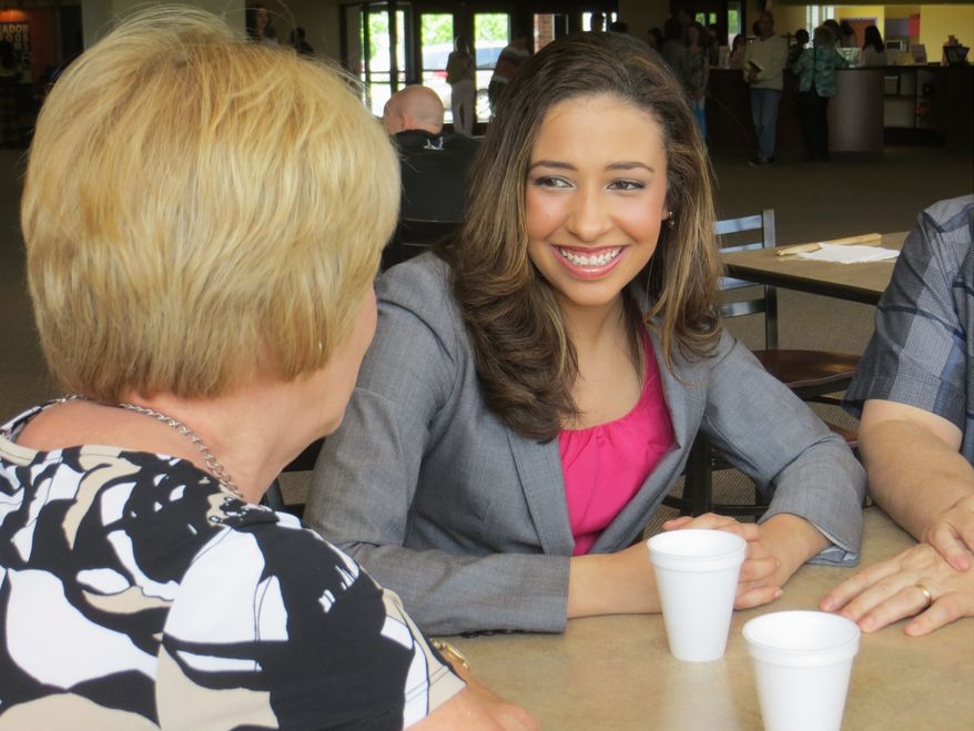 'Next generation': The young, articulate Erika Harold has won admiration from Illinois Republicans, but party officials are not happy about her run for Congress against a GOP incumbent in a swing district. (Erika Harold For Congress)