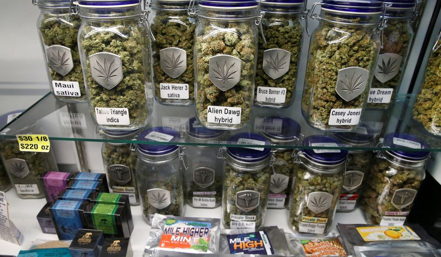 Marijuana and cannabis-infused products are displayed at Medicine Man marijuana dispensary, which is to open as a recreational retail outlet in Denver on Wednesday.