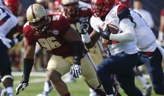 Arizona running back Ka'Deem Carey (25) rushes up field asile Boston College defensive lineman Kaleb Ramsey (96) pursues during the first half of the AdvoCare V100 Bowl NCAA college football game, Tuesday, Dec. 31, 2013, at Independence Stadium in Shreveport, La. (AP Photo/Rogelio V. Solis)