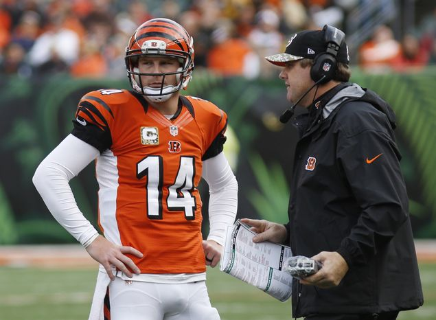 Cincinnati Bengals quarterback Andy Dalton (14) talks with offensive coordinator Jay Gruden in the first half of an NFL football game against the Cleveland Browns, Sunday, Nov. 17, 2013, in Cincinnati. (AP Photo/David Kohl)