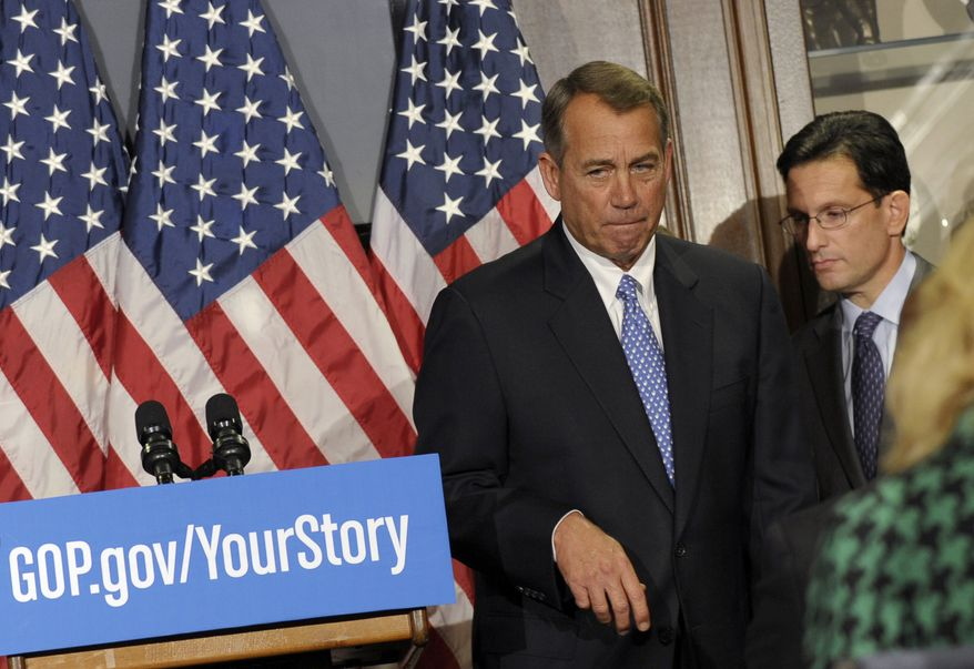 ** FILE ** In this Oct. 23, 2013, file photo House Speaker John Boehner of Ohio, left, and House Majority Leader Eric Canton of Va., right, leave after a news conference on Capitol Hill in Washington. (AP Photo/Susan Walsh, File)