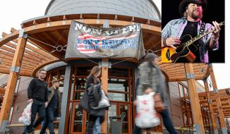 "Signs reading ""no guns permitted"" have been displayed on the front doors to Toby Keith's I Love this Bar & Grill, Woodbridge, Va. (Andrew Harnik/The Washington Times)"