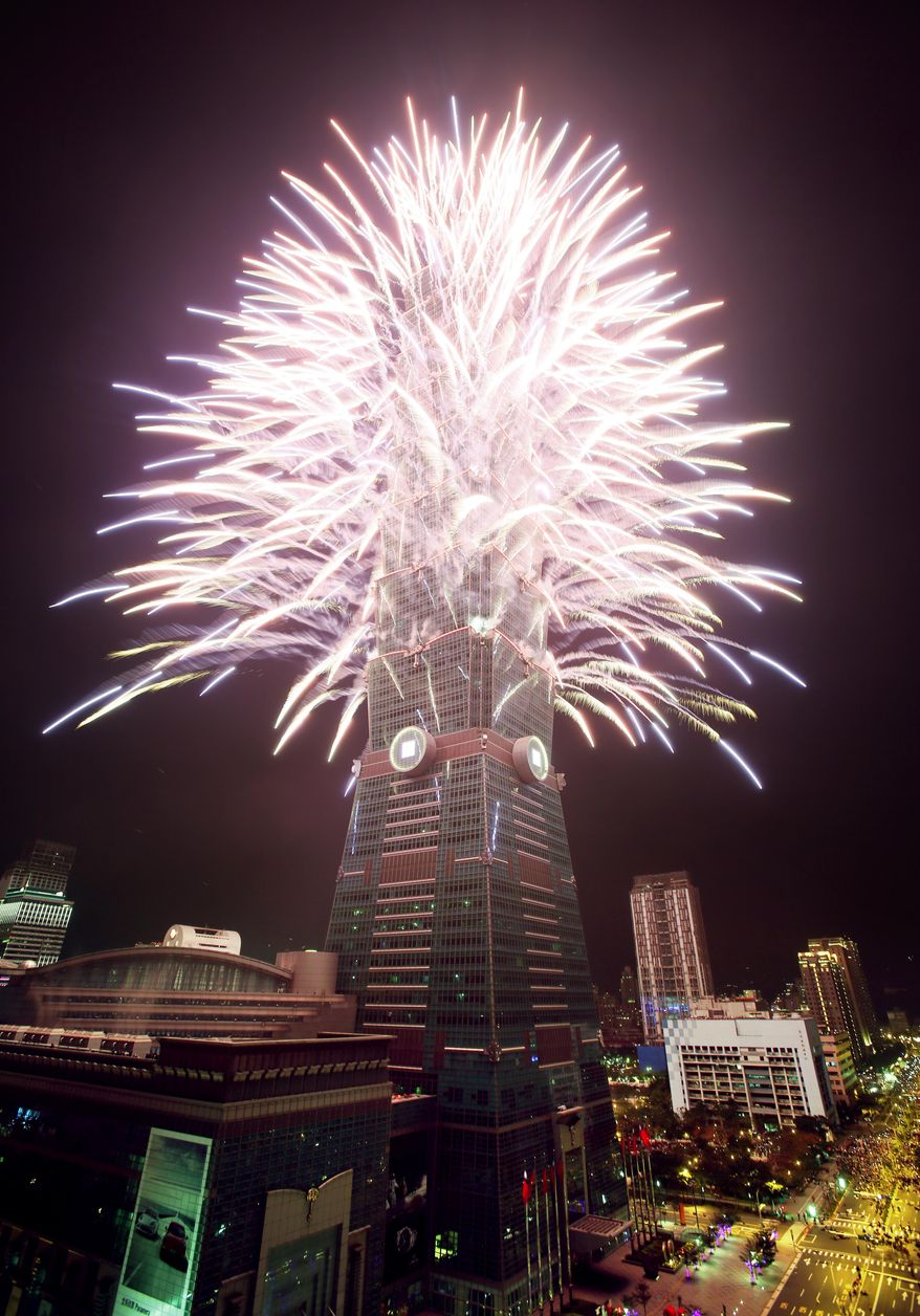 A fireworks display is set off from the Taipei101 skyscraper during New Year's Eve celebrations in Taipei, Taiwan, Tuesday, Dec. 31, 2013. (AP Photo/Wally Santana)