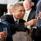 President Barack Obama, with First Lady Michelle Obama, toasts with Vice President Joe Biden during the inaugural luncheon at the U.S. Capitol in Washington, D.C., Jan. 21, 2013. (Official White House Photo by Pete Souza)  This official White House photograph is being made available only for publication by news organizations and/or for personal use printing by the subject(s) of the photograph. The photograph may not be manipulated in any way and may not be used in commercial or political materials, advertisements, emails, products, promotions that in any way suggests approval or endorsement of the President, the First Family, or the White House.