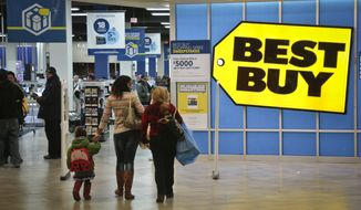 ** FILE ** In this Nov. 23, 2013, file photo, shoppers enter a Best Buy in New York. In 2013, (AP Photo/Bebeto Matthews, File)