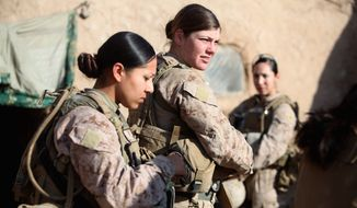 Marine Corps Sgt. Jessica Domingo (right) and Cpl. Daisy Romero, part of a female engagement team, worked with infantry Marines in Afghanistan by engaging women and children in support of the International Security Assistance Force. (Associated Press)
