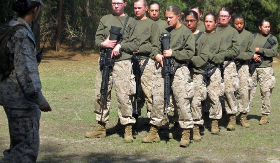 As female recruits train at Parris Island, S.C., Brig Gen. Loretta Reynolds, the first female general in charge at the Marine Corps depot, says she is confident that they would do well in combat. (Associated Press) **FILE**