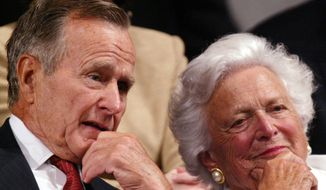 Former President George H.W. Bush and former first lady Barbara Bush listen as, President Bush, accepts the party nomination at the Republican National Convention Thursday, Sept.2, 2004, in New York. (AP Photo/Paul Sancya)