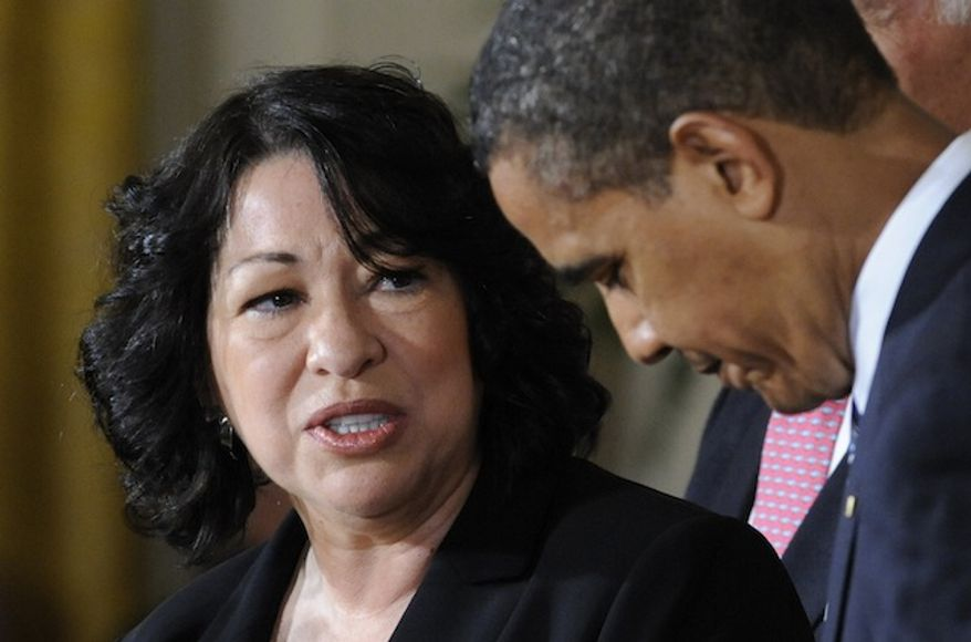 **FILE** Supreme Court choice Sonia Sotomayor speaks to President Obama during an announcement on May 26, 2009, in the East Room of the White House. (Associated Press)