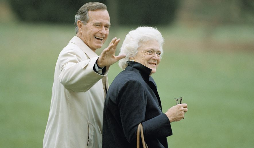 Then-President George H.W. Bush waves as he and first lady Barbara Bush leave the White House in Washington, Nov. 5, 1992, for a weekend trip to Camp David, Maryland. (AP Photo/Wilfredo Lee) ** FILE **