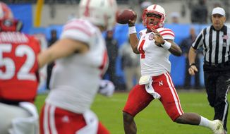 Nebraska quarterback Tommy Armstrong Jr. (4) passes the ball during the first half of the Gator Bowl NCAA college football game against Georgia, Wednesday, Jan. 1, 2014, in Jacksonville, Fla. (AP Photo/Stephen B. Morton)