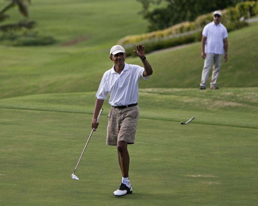 President Barack Obama waves to the gallery watching him play on the 18th green at the Mid Pacific Country Club, Wednesday, .Jan. 1, 2014 in Lanikai on the island of Oahu, in Hawaii. (AP Photo/Marco Garcia)