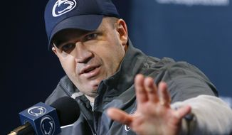 FILE - In this April 20, 2013, file photo, Penn State coach Bill O'Brien answers questions during a news conference in State College, Pa. Two people familiar with the negotiations said Tuesday night, Dec. 31, 2013, that O'Brien has reached an agreement to coach the Houston Texans. The people spoke to The Associated Press on the condition of anonymity because an official announcement hasn't been made. (AP Photo/Keith Srakocic)