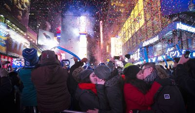 Miranda Echerarria and Christian Prieto, of Niagra, N.Y. kiss at the stoke of midnight during the New Year's Eve celebrations in Times Square, Wednesday, Jan. 1, 2014, in New York. (AP Photo/John Minchillo)