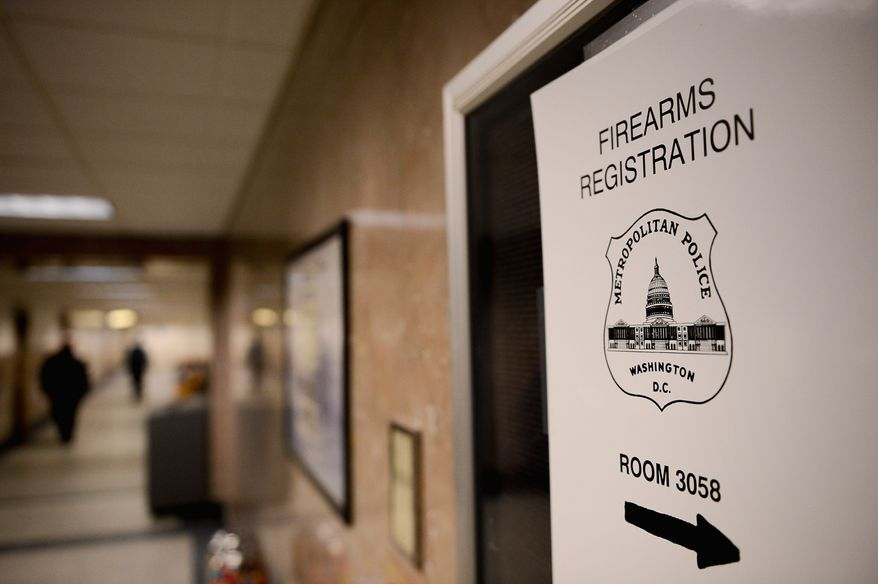 The Metropolitan Police Department on Thursday began its gun re-registration process with owners getting fingerprinted and submitting to background checks. (andrew harnik/the Washington Times)
