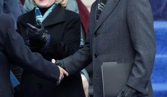 Former President Bill Clinton swore in newly minted New York Mayor Bill de Blasio, accompanied by Hillary Rodham Clinton who sported a snappy new hairdo. (ASSOCIATED PRESS)
