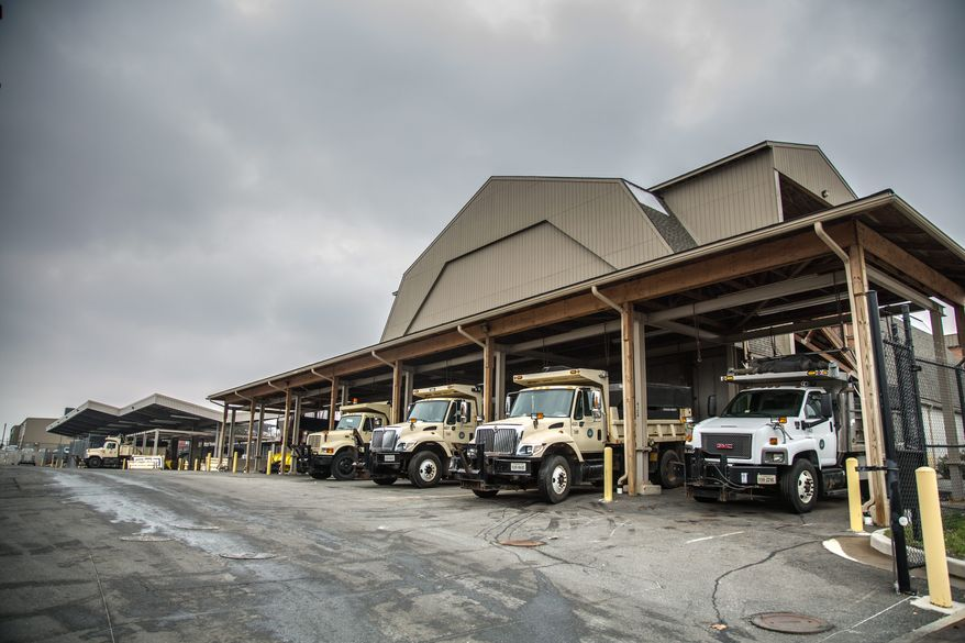 City vehicles loaded up with salt wait for their snow plows to be attached as they prepared on Thursday for the arrival of snow in Alexandria, Va. (andrew s. geraci/the Washington Times)