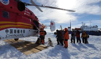 ** FILE ** In this photo provided China's official Xinhnua News Agency, passengers from the trapped Russian vessel MV Akademik Shokalskiy, seen at right, prepare to board the Chinese helicopter Xueying 12 in the Antarctic Thursday, Jan. 2, 2014. (AP Photo/Xinhua, Zhang Jiansong) NO SALES