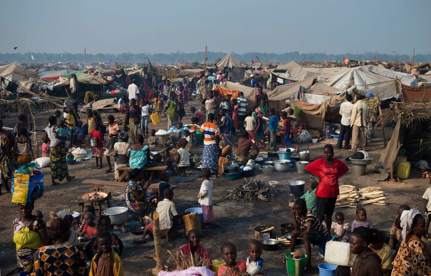 People displaced by violence attempt to create a semblance of daily life, in a sprawling camp at Mpoko Airport, in Bangui, Central African Republic, Thursday, Jan. 2, 2014. (AP Photo/Rebecca Blackwell)