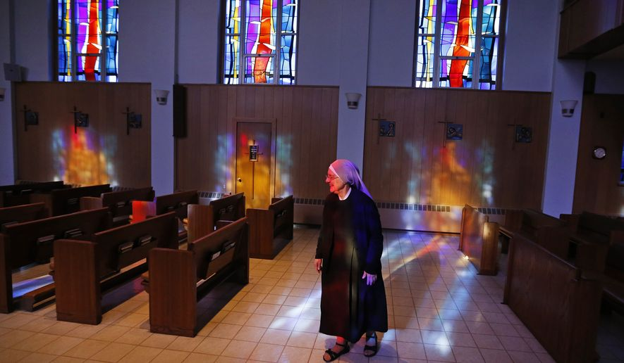 Mother Patricia Mary walks in the chapel at the Mullen Home for the Aged, run by Little Sisters of the Poor, in Denver, Colo., Thursday, Jan. 2, 2014. (AP Photo/Brennan Linsley) ** FILE **