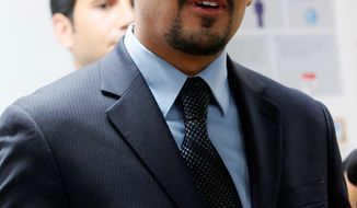 File - In this Aug. 27, 2013 file photo, Sergio Garcia speaks at The Coalition for Humane Immigrant Rights of Los Angeles news conference in Los Angeles. The California Supreme Court granted a law license on Thursday, Jan. 2, 2014, to Garcia, who is living in the United States illegally. Garcia, who graduated from law school and passed the state bar exam, can begin practicing law despite his immigration status. He arrived in the U.S. illegally 20 years ago to pick almonds with his father. (AP Photo/Nick Ut, File)
