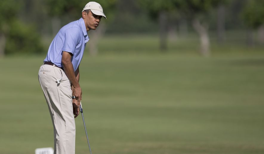 President Barack Obama reacts as he watches his putt on the second green at Kaneohe Klipper Golf Course on Marine Corps Base Hawaii in Kaneohe Bay, Hawaii, Thursday, Jan. 2, 2014. The first family is in Hawaii for their annual holiday vacation.  (AP Photo/Carolyn Kaster)