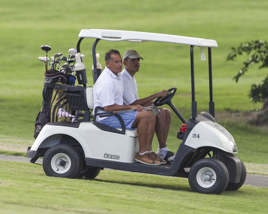 President Barack Obama drives a golf cart with long time friend Bobby Titcomb off the 18th green at the Mid Pacific Country Club, Wed. Nov. 1, 2014 in Lanikai on the island of Oahu.  (AP Photo/Marco Garcia)