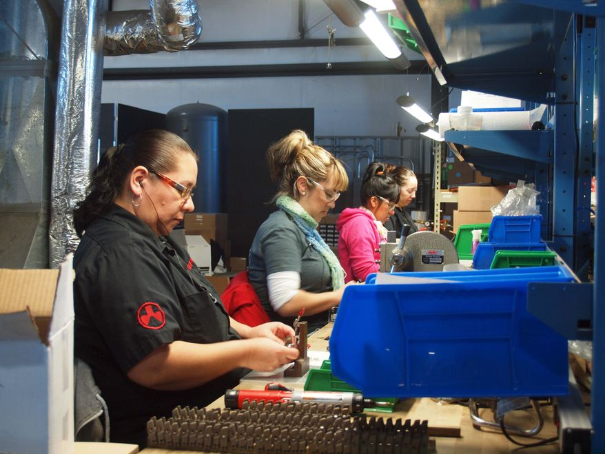 Magpul Industries is moving its manufacturing facility and corporate headquarters out of Colorado after the state legislature approved sweeping gun-control legislation in 2013. Here, Magpul employees in Erie, Colo., assemble firearms accessories and other products.(Photos by Stan Lukowicz)
