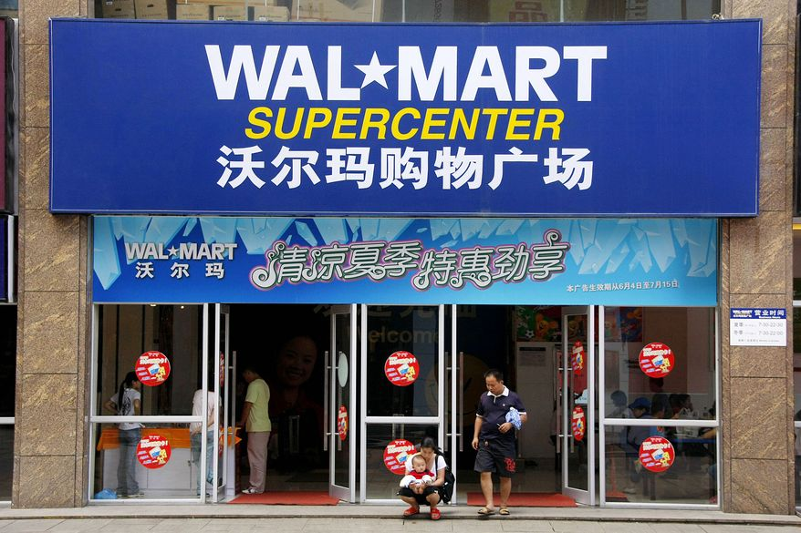 **FILE** Customers walk out from the gate of a Wal-Mart supermarket in Loudi, Hunan Province, China, Friday June 20, 2008. (Associated Press)