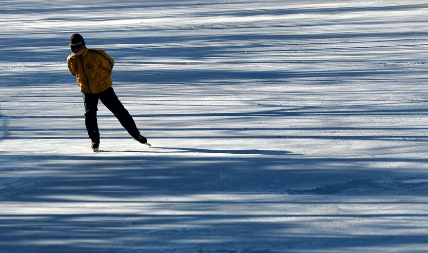 ** FILE ** A skater braves the cold weather as they make their way along the Rideau Canal skateway in Ottawa on Friday, Jan. 3, 2014. (AP Photo/The Canadian Press, Sean Kilpatrick)