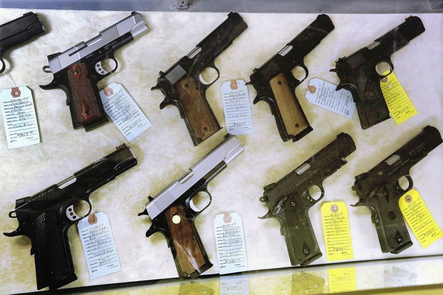 D.C. officials say the opinion issued Wednesday by a Texas federal judge that found unconstitutional a federal ban on the direct sale of handguns from federal firearms dealers to out-of state residents has limited applicability at this time. (AP Photo/Seth Perlman, File)